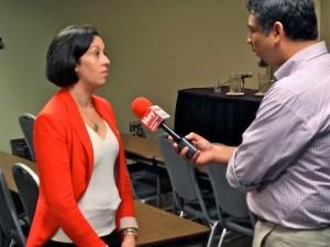 Kathleen being interviewed regarding their pro bono work at the border.